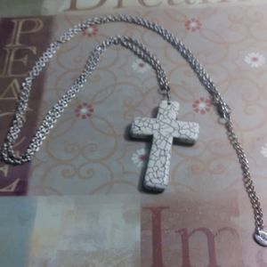 Claire's Marble-like Cross necklace